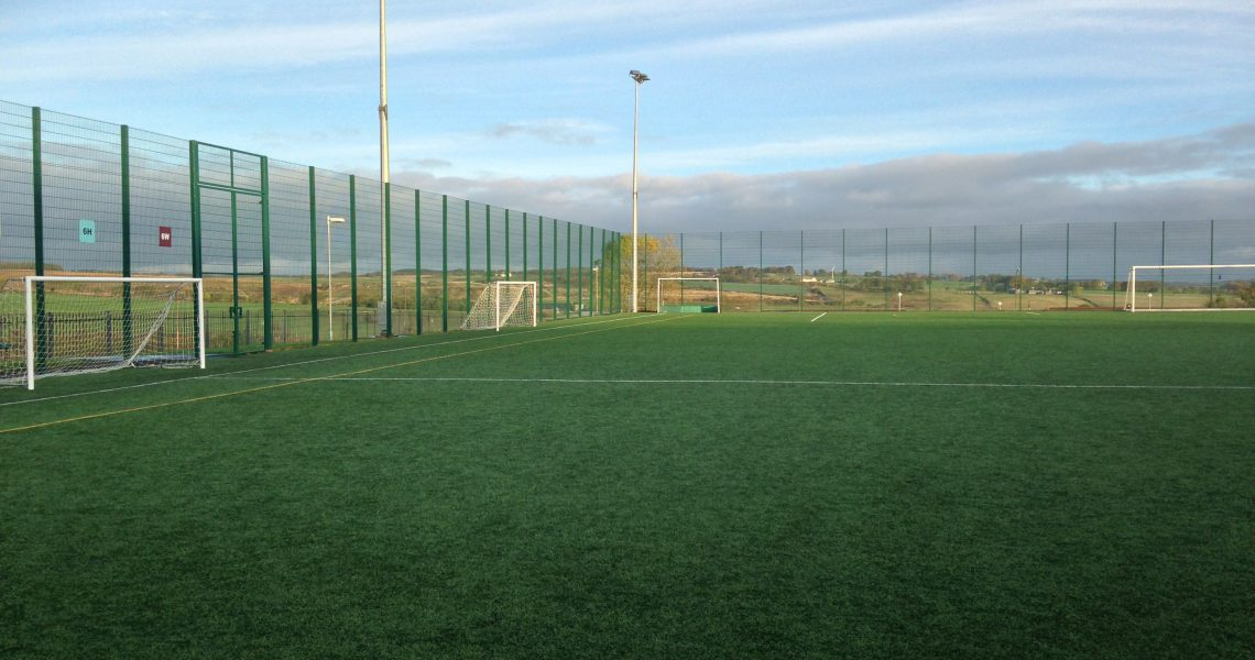 Lochrin BallGUARD fencing installed around a football pitch.