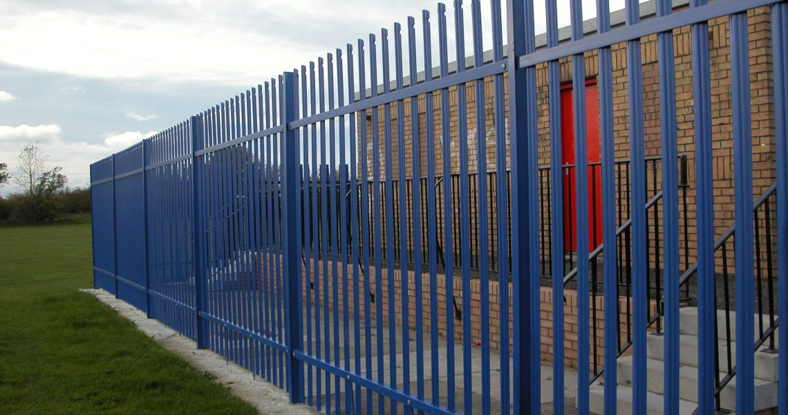 A blue Lochrin Classic fence installed around a facility.