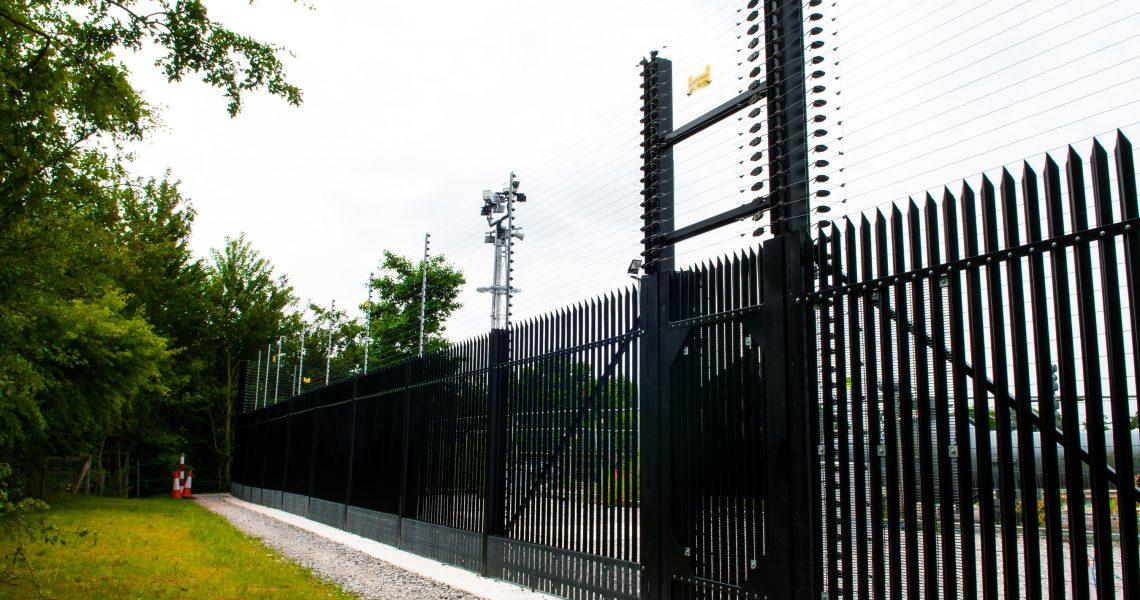 A black Lochrin Combi CPNI fencing installation.